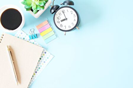 Still life, business, office supplies, working day, meeting or education concept : Top view of notebook, clock, pen and coffee cup on blue background with copy space ready for adding or mock up Archivio Fotografico - 140001171