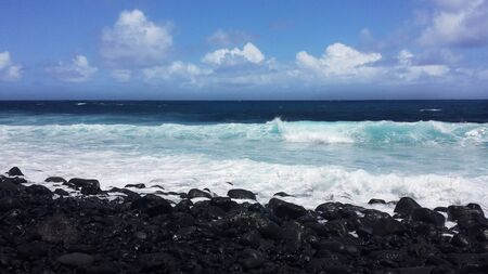 Black Sand beach at high tides, only black pebbles showing
