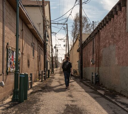 Man walking down an isolated alley