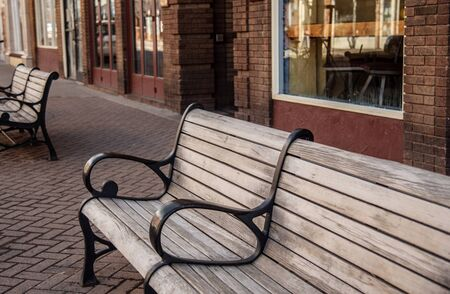 Lonely benches on a paved sidewalk
