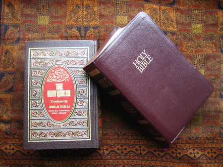 Holy Koran and Holy Bible Stock Photo