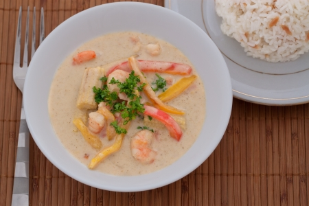 baby rice: Green Thai curry with prawn, baby corn, pepper and rice on side Stock Photo