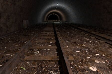 light at the end of the tunnel: computer rendered illustration of dark train tunnel