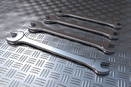 rendered illustration the Different sizes of wrenches on steel floor Stock Photo