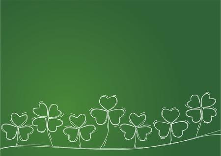 緑の背景に白い輪郭クローバー