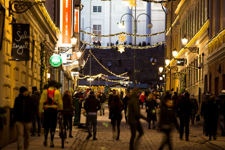 HELSINKI, FINLAND - DECEMBER 17, 2017: Festive street with Christmas decorations overlooking the Cathedral on the Senate square.  A lot of people and bright decorations.