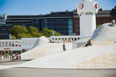 Helsinki, Finland- July 25 2019: New art museum Amos Rex in the center of Helsinki. Modern northern architecture. people relaxing on futuristic slopes, enjoying sunshine on the square. Editöryel