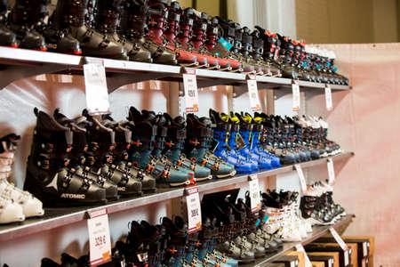 HELSINKI, FINLAND - NOVEMBER 15, 2019: Ski shop sale. Rows of ski boots in sport equipment store