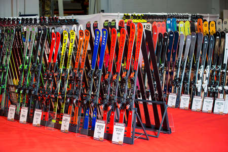 HELSINKI, FINLAND - NOVEMBER 15, 2019: Ski shop sale. Rows of colourful skis in sport equipment store