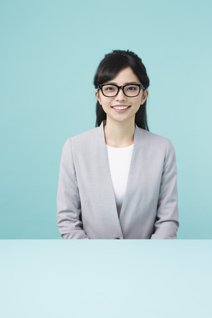 A woman with black rim glasses smiling
