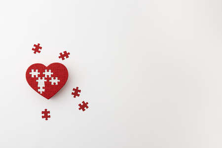a heart-shaped puzzle placed on a white background