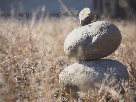 three-tiered art made of stone