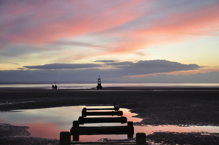 another: an image taken at crosby beach anthony gormleys another placeof the pipeline running out to sea just after sunst