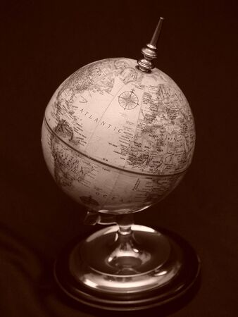 sates: World globe displaying the Atlantic Ocean on black background. Stock Photo