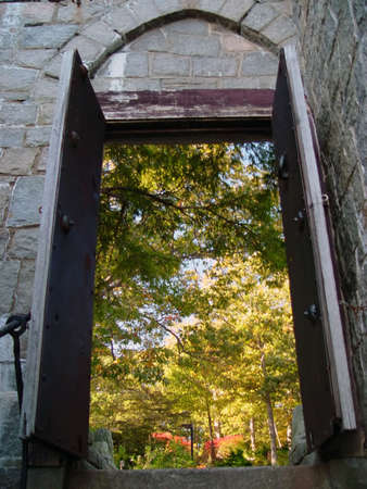 Steps up to an exitentry door of Hammond Castle in Gloucester Massachusetts.