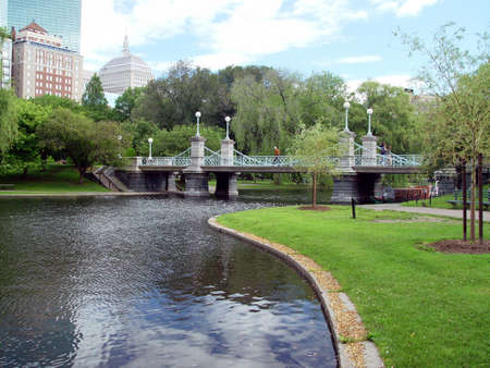 Beautiful Boston Public Gardens in the summer with view of Ritz in the background.