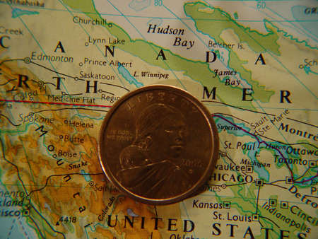 US dollar coin on map of United States
