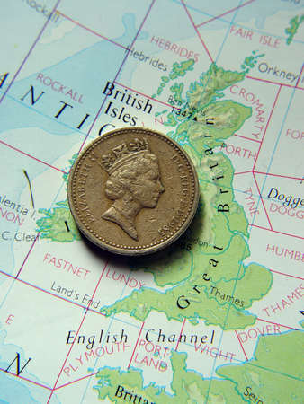 British one pound coin on map of Great Britain