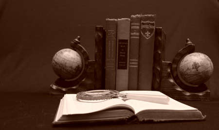 Globe bookends with magnifying glass.