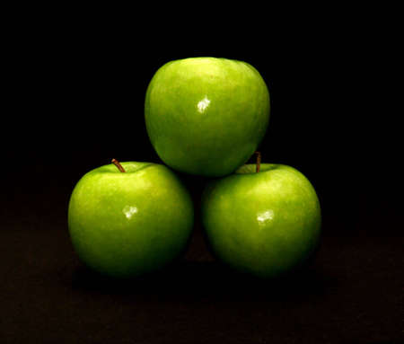 Granny smith apples on black background