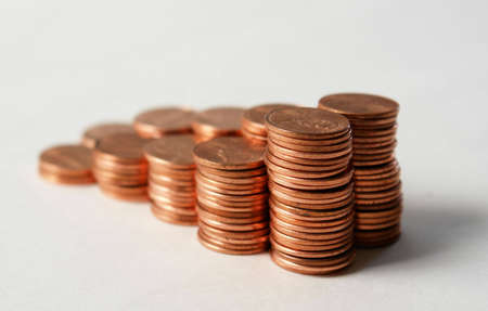 Stacks of pennies against a white background