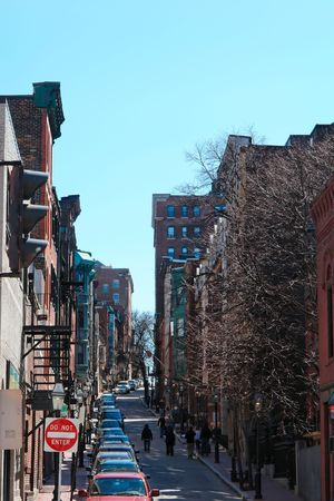 Looking up one of the many brownstone lined streets in bostons beacon hill district,