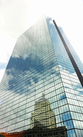 vividly: the sky and buildings are vividly reflected on large glass mirrored skyscraper building in bostons back bay Stock Photo