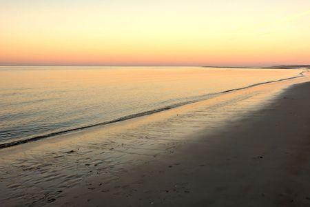 Sunset on Cranes beach in Ipswich Massachusetts with sea gulls