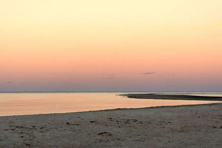 the sky turns beautiful colors in this serene sunset on Crane's beach in Ipswich Massachusetts Stock Photo - 1961814