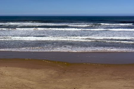 coast line: early morning waves come crashing in from the pacific ocean to the oregon coast