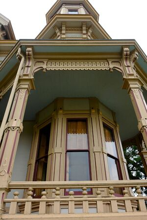 detail of old victorian painted lady home on the coast of oregon