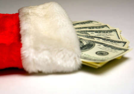 christmas stocking laying down with cash coming out of the top Stock Photo