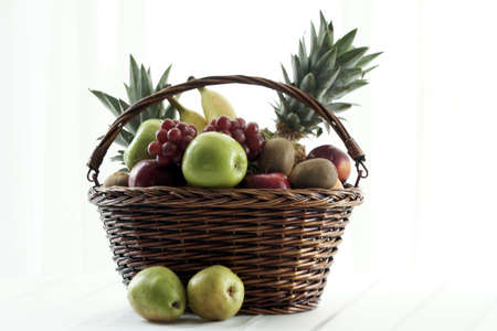 fruit basket: full fruit basket with apples and grapes and other fruit Stock Photo