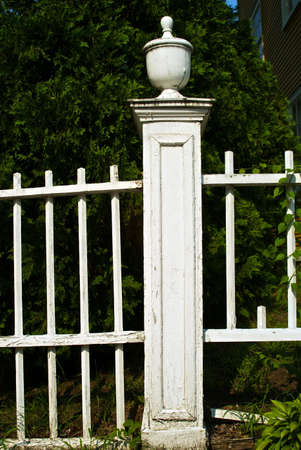 old new england white picket fence, broken and in need of repair Stock Photo