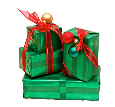 stack of beautifully wrapped and well adorned christmas presents with ribbons and ornaments on white Imagens