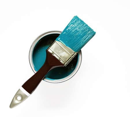 Turquise painted brush on a paint bucket Stock Photo
