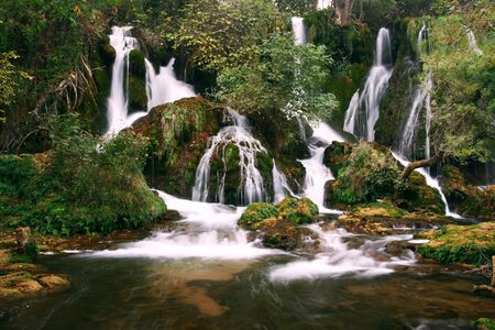 serene waterfall cascades in wilderness