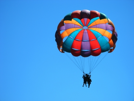 parachute jump: flying with colorful parachute