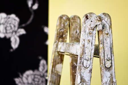 wallpapering job on ladders Stock Photo