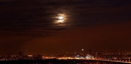 Kiev. Moon over the city.