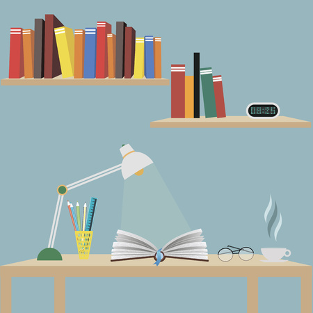 One open book on the table. The light of the desk lamp is aimed at the book.