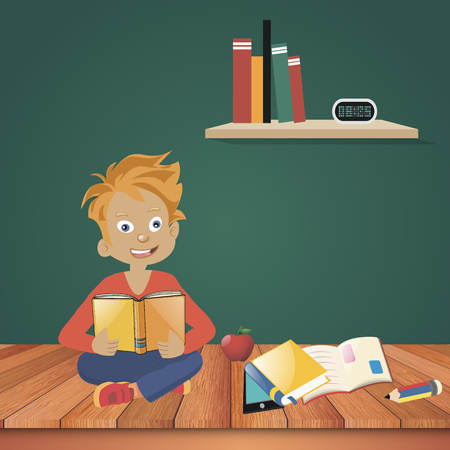 A boy stands and reads a book