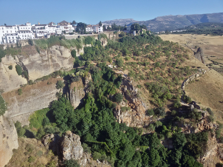 Green bushes on the rocky mountains in Ronda, Spain