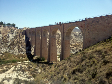Bridge in the middle of nowhere at sunny day, Spain Stock Photo