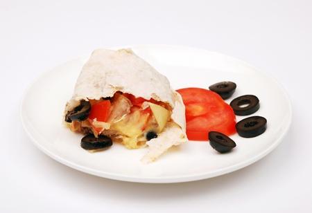 Chicken shawarma sandwich on a white plate.