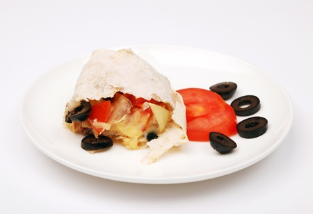 Chicken shawarma sandwich on a white plate.