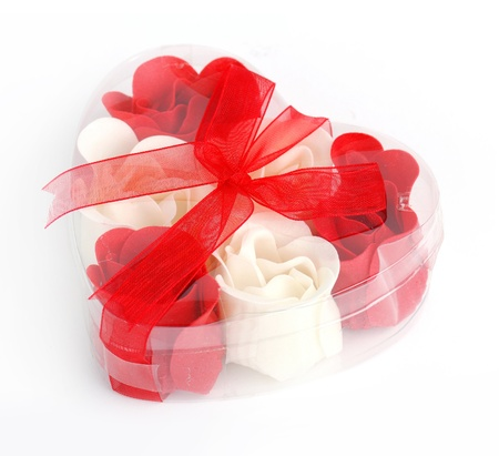 Red and white soap roses in box with red bow.  Stock Photo