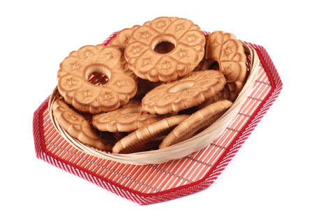 Basket with cookies on a napkin isolated