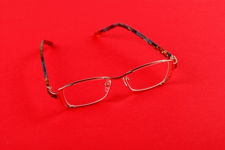 educations: The glasses on red background Stock Photo