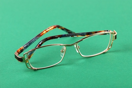 educations: The glasses on green background Stock Photo
